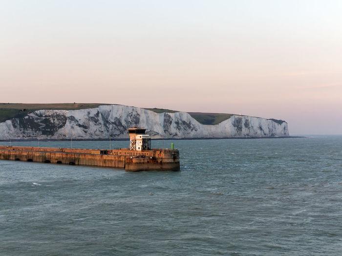 Harbor against white cliffs