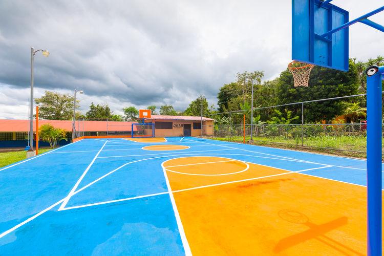 Empty basketball court against sky