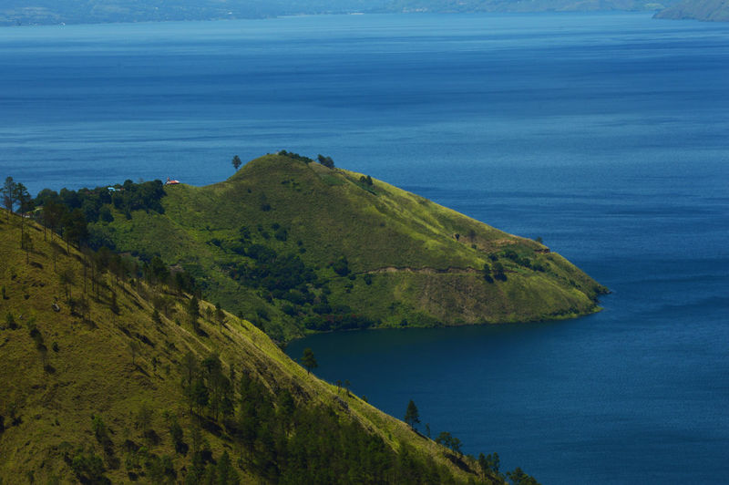 Beautiful lake toba mountains are seen from a height.