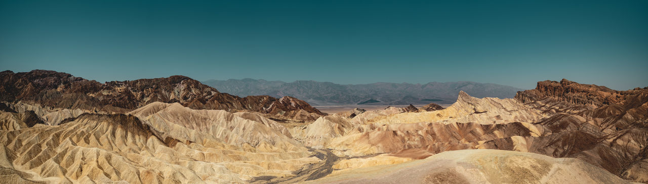 Panorama shot of the Amargosa Range seen from Zabriskie Point, Death Valley National Park, USA. Submitted to the Stay Out mission: A perfect Stay Out moment because this landscape is so extraordinary inspiring that I just want to walk through and immerse in it. Stay Out Eroded Formation Outdoors No People Rock Formation Land Mountain Range Rock Sky Desert Landscape Mountain Scenics - Nature Death Valley Death Valley National Park Zabriskie Point Dramatic Landscape Panorama High Resolution Amargosa Range California USA Roadtrip Travel Destination Sedimentary Rock Bizarre Extraordinary  Iconic Landmark Hiking Adventure Discover Places Iconic Landmark Travel Destinations My Best Photo Wonders Of Nature Explore Desert Desert Landscape Vastness Places Around The World Places You Must To See Formation Flow  Iconic Landscape Wide Angle Openess Wideness