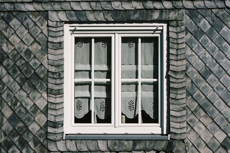 Typical thuringian window framed with slate Thuringia Architecture Building Building Exterior Built Structure City Closed Day Germany Glass - Material House No People Outdoors Pattern Protection Residential District Roof Tile Safety Shale Slate Stone Material Wall Wall - Building Feature Window Window Frame