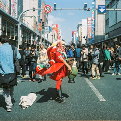 Architecture Built Structure Casual Clothing City City Life City Street Cosplay Crowd Day Girl Group Of People Japan Large Group Of People Leisure Activity Lifestyles Market Market Stall Medium Group Of People Mixed Age Range Outdoors Road Street