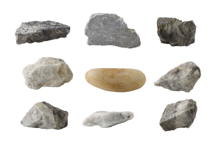 Close-up of stones against white background