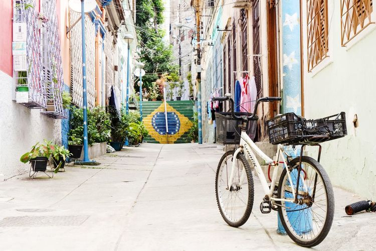 Rio EyeEm Best Shots EyeEmNewHere Street Photography Graffiti Graffiti Art Graffiti Wall Bicycle Day The Way Forward Transportation Outdoors Multi Colored No People City Architecture Built Structure Building Exterior Stationary Mode Of Transport Mobility In Mega Cities