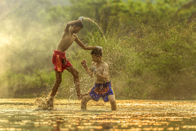 Boys playing at water