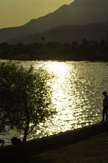 A walk by the lake Water Silhouette Nature Sunlight Lake Sunset Outdoors Mountain Beauty In Nature Sky Lake View Lakeshore Golden Light Ajijic Chapala Lake Gold Colored Mexico Jalisco