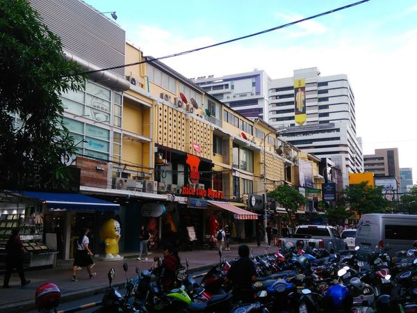 Building Exterior City Street City Life Built Structure Architecture Large Group Of People Outdoors Modern Sky People City Cityscape Bangkok Day Thailand Siam Square Façade Building Parking Lot Motorcycles