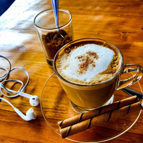 High angle view of coffee with cinnamons on table