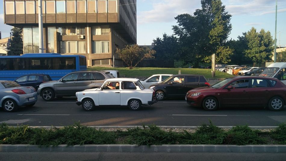 A classic in the crowd of modern. Trabant Car Land Vehicle Transportation Street Road Travel City City Life Day Hungary Budapest