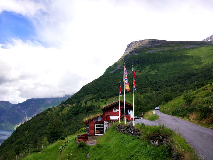 Beauty In Nature Day Flag Geiranger Fjord Geiranger,Norway Geirangerfjord Grass Green Color Landscape Mountain Mountain Range Nature No People Outdoors Scenics Sky Tranquil Scene Tranquility
