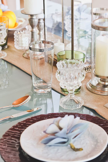 Detail image of Elegant dining table setting Dining Room Elegant Close-up Day Dining Dining Area Dining Table Dining Tables And Chairs Diningroom Drink Drinking Glass Food Food And Drink Freshness Healthy Eating High Angle View Indoors  No People Plate Ready-to-eat Table Water
