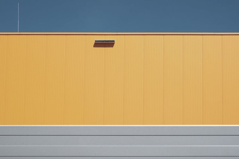 Full frame shot of yellow wall against building