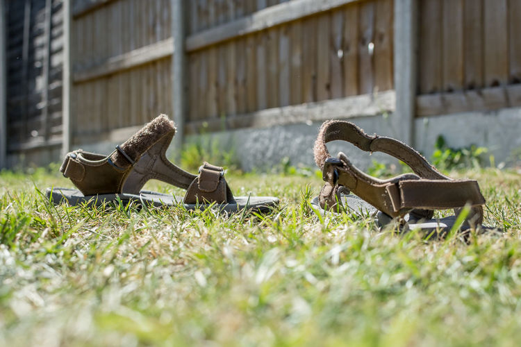 Abandoned shoes on field