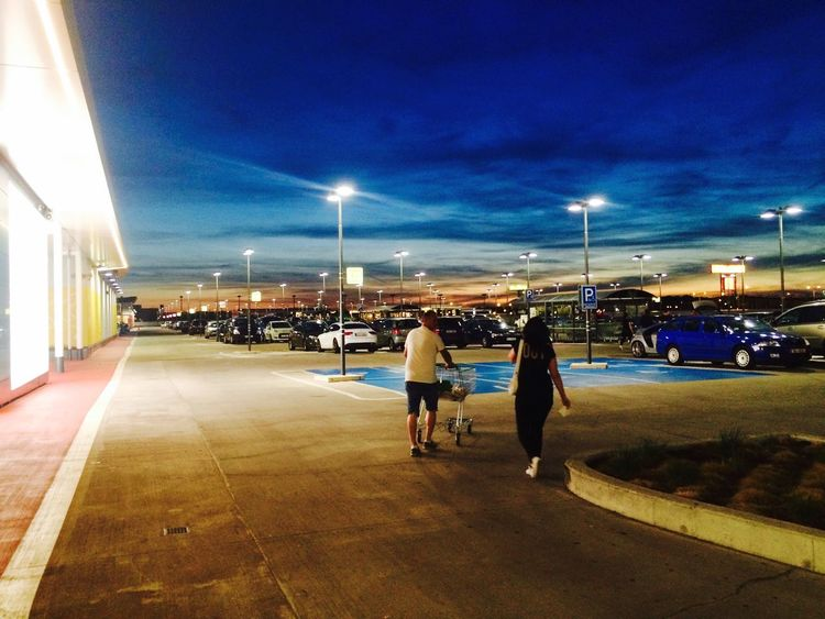 Real People Illuminated Built Structure Architecture Building Exterior Sky Two People Rear View Men Outdoors Togetherness Night Nature Shopping ♡ Shop Parking Place Sunset EyeEm Gallery EyeEm Best Edits Colors Sommergefühle
