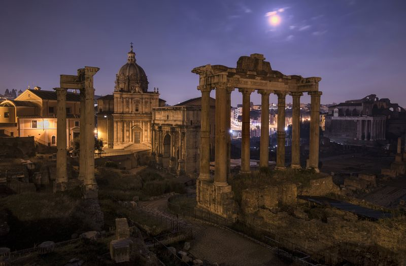 Roman forum against sky at dusk
