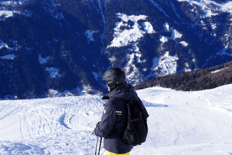 Full length of person on snowcapped mountain