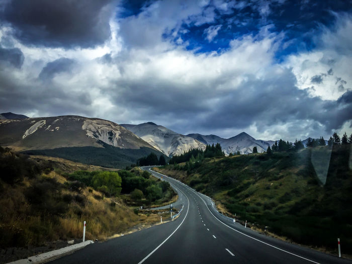 Beauty In Nature Car Cloud Cloud - Sky Cloudy Diminishing Perspective Landscape Mountain Mountain Range Nature New Zealand Road Road Marking Scenics Sky Street The Way Forward Tranquil Scene Tranquility Transportation Vanishing Point