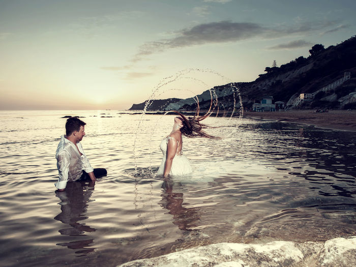Adult Beach Beauty In Nature Couple - Relationship Females Land Leisure Activity Lifestyles Love Men Nature Outdoors People Positive Emotion Real People Scenics - Nature Sea Sky Togetherness Two People Water Women
