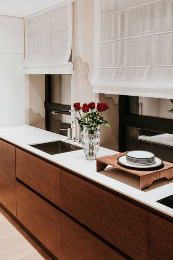 Home Domestic Room Home Interior Furniture Indoors  Home Showcase Interior Table Domestic Kitchen No People Household Equipment Kitchen Cabinet Plant Vase Neat Food And Drink Flowering Plant Flower Sink Architecture Modern Flooring Luxury