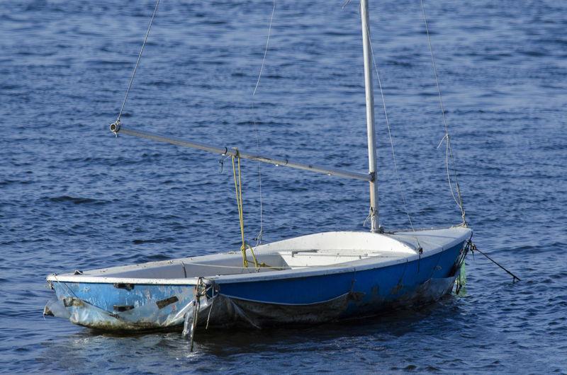 Blue and white fishing boat anchored at ribeira beach. salvador bahia brazil.