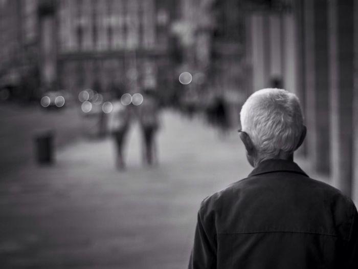 Rear view of senior man in street