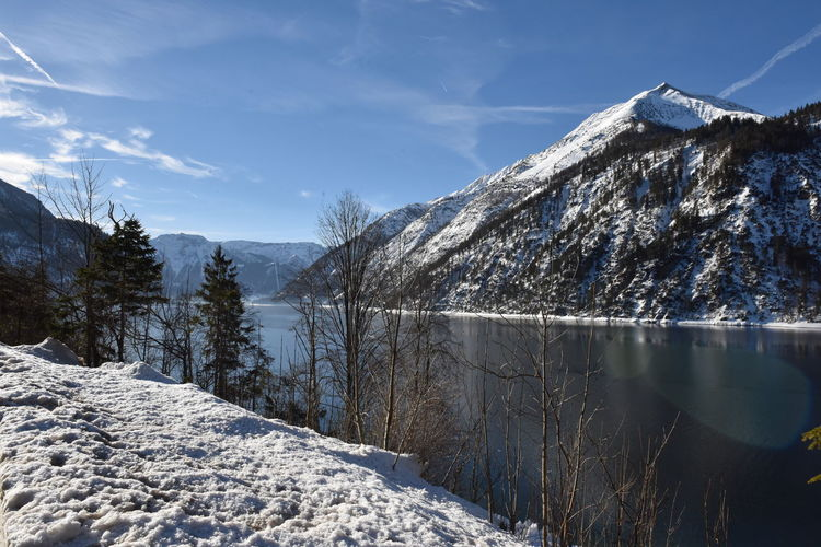 Scenic View Of Frozen Lake By Mountain Against Sky