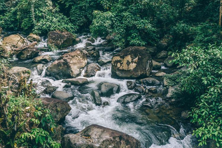 Full frame shot of stream through rocks