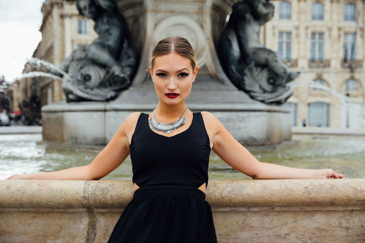 Portrait of confident young woman in city