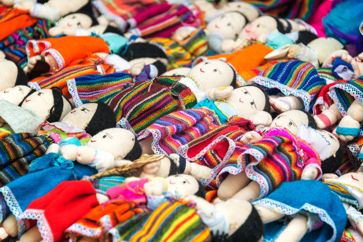Souvenir dolls for sale in traditional clothing in Otavalo, Ecuador Beautiful Business Clothes Clothing Colorful Craft Culture Dolls Ecuador Ethnic Imbabura Indian Indigenous  Market National Object Otavalo Otavalo, Ecuador South America Souvenir Textile Tourism Tradition Traditional Travel