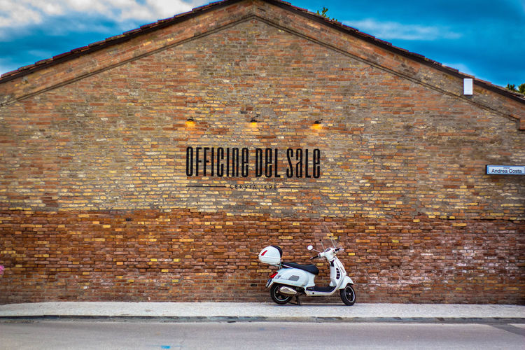 Bicycle on street against building