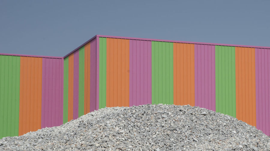 Close-up of multi colored cargo container against clear sky