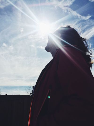Warm rays. Lens Flare Sunbeam Sunlight Sky Rear View One Person Sun Real People Leisure Activity Day Female Woman Bright Future Foresight Lifestyles Outdoors Nature Young Adult Warm Clothing Close-up People