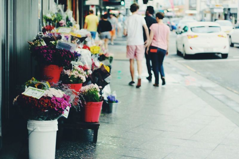 Flower stand on sidewalk