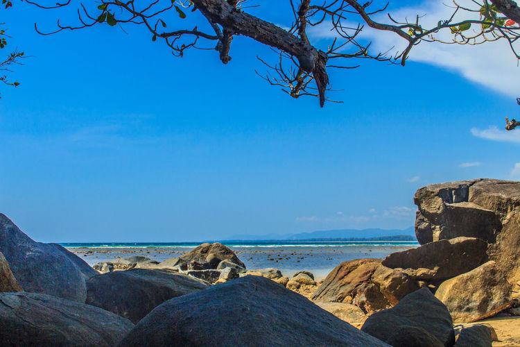 Beautiful rock stones on the beach when the sea water receded with dramatic blue sky background on the cloudy day. Rock Rocky Rocky Beach Rocky Beach Cove Rocky Beach Panoramic View Rocky Coastline Rocky Shore Beauty In Nature Blue Blue Sky Blue Sky And Clouds Branch Clear Sky Day Horizon Over Water Nature No People Outdoors Rock - Object Rock Beach Rocky Beach With Sand Rocky Landscape Scenics Sea Sky Stone Beach Stones Tranquil Scene Tranquility Tree Water