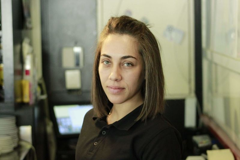 Portrait of smiling young woman at store