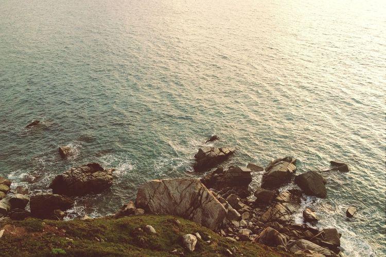Mountain rocks against sea