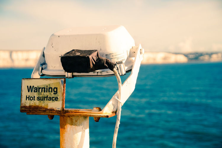 Be careful... Dover Sign Signs Beauty In Nature Blue Close-up Day Electric Light Electricity  Focus On Foreground Horizon Over Water Lamp Nature No People Outdoors Sea Sky Sunlight Text Water White Cliffs Of Dover