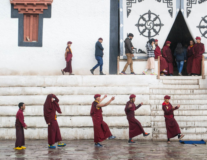 Buddhist monks at Hemis Monastery practise for the upcoming festival while visitors walk towards the main temple. Buddhist Monastery Buddhist Monk India LehLadakh Tibetan Buddhism Tibetan Buddhist Temple Tibetan Monastery Architecture Buddhism Buddhist Monks Building Exterior Built Structure Day Full Length Ladakh Lovers Leh Medium Group Of People Men Monk  Outdoors People Real People Sculpture Tibetan Culture