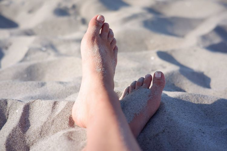 Low section of person on sand