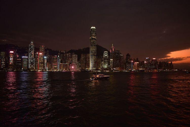 Illuminated buildings in city at night in hong kong
