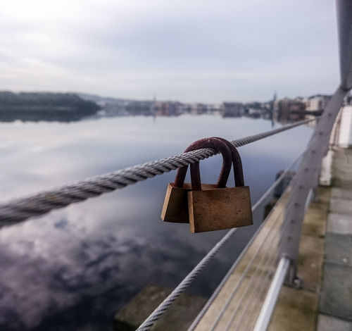 Padlock Love Lock Lock Metal Protection Railing Security Love Safety Hope - Concept Close-up Romance Lake Hanging Bridge - Man Made Structure No People Day Water Outdoors Vertical