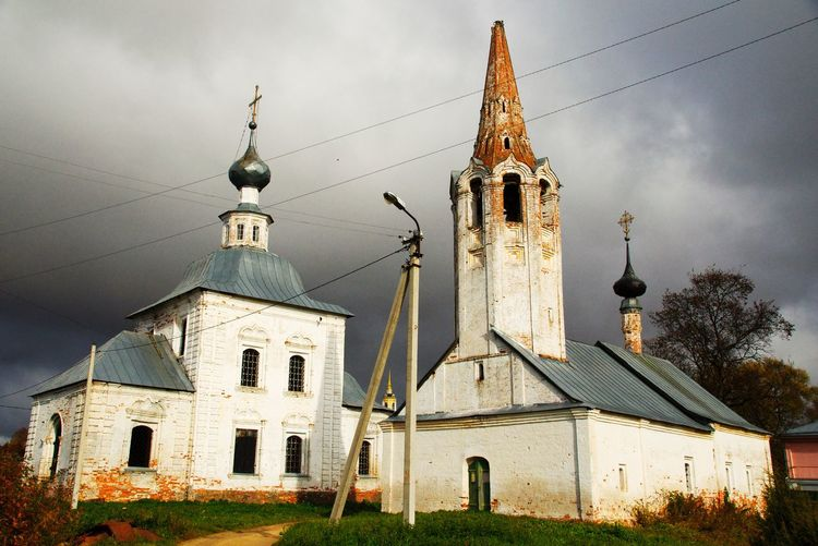 Old Churches Against Cloudy Sky