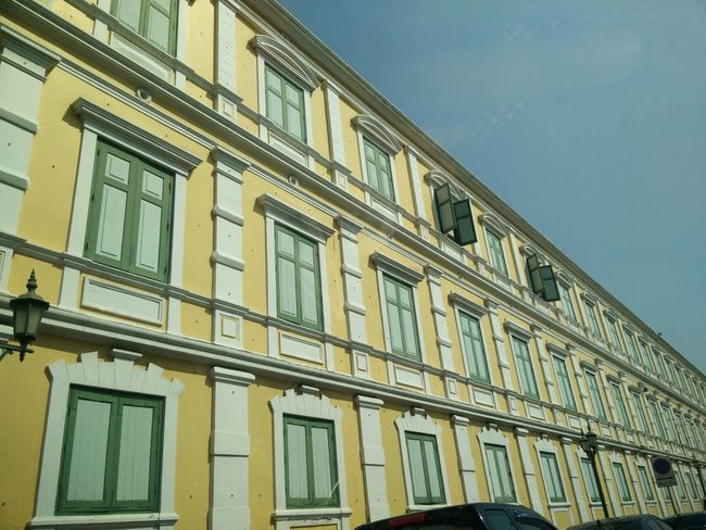 Ancient Buildings Cement Wall Close Window Corner Crosswise Lamps Lighting Poles Many Windows Near Sanam Luang-Bangkok Open Windows Rectangular Windows Shop Gallery Sky Wall Window Green Yellow Building ัyellow Wall