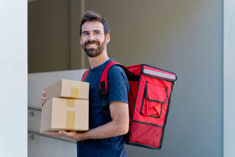 Portrait of smiling man standing in box