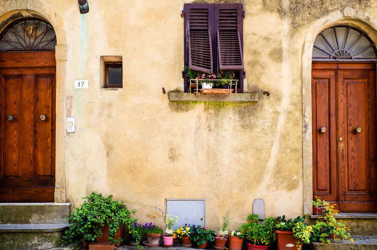 Full frame shot of potted flowers by residential building exterior in Volterra, Province of Pisa, Tuscany, Italy. Façade Flower Pot Mediterranean Countries Mediterranean Culture Architecture Building Exterior Built Structure Cultures Day Door Europe Flower House Italian Culture No People Old Outdoors Plant Potted Plant Shutter Street Town Wall - Building Feature Window Window Box Visual Creativity The Architect - 2018 EyeEm Awards The Street Photographer - 2018 EyeEm Awards