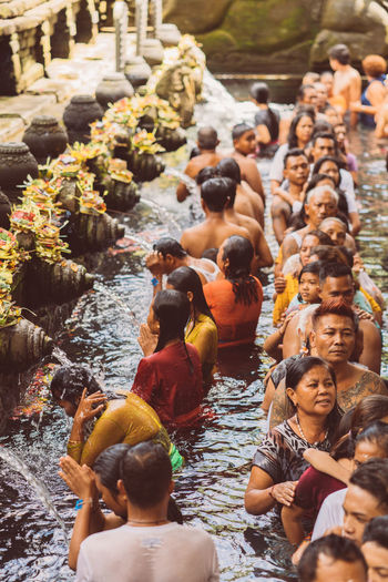 Bali INDONESIA Bali Temple Temple Water Temple Religious Festival Hindu Hinduism Real People Lifestyles Men Group Of People Large Group Of People Day Water Crowd Nature Women Leisure Activity Adult Outdoors Motion High Angle View Enjoyment River Spirituality Flowing Water