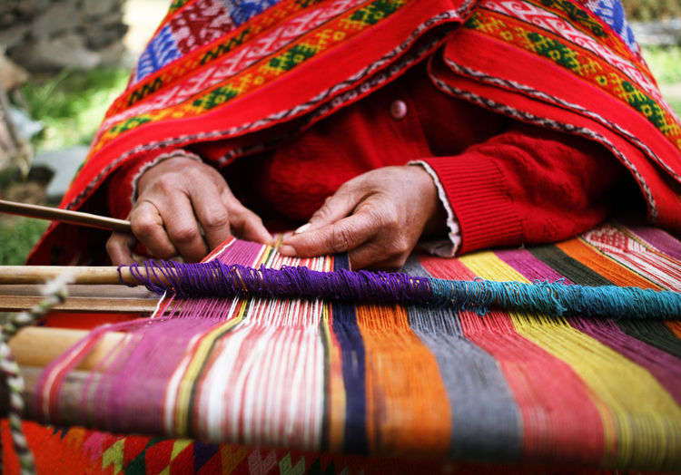 Traditional Peruvian Weaving Cusco Cusco, Peru Hands Textiles Weave Woman Adult Art And Craft Clothing Colorful Craft Creativity Handicraft Loom Multi Colored One Person Peruvian Pisac Skill  Textile Thread Traditional Clothing Weaver Weaving Wool
