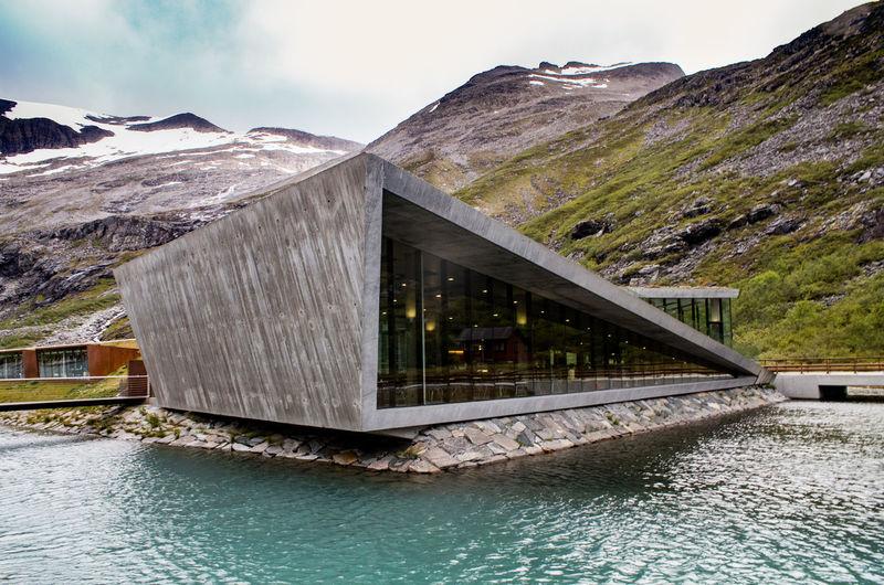 Trollstigen Rest Stop Area Norway Architecture Beauty In Nature Built Structure Day Lake Mountain Mountain Range Nature No People Outdoors Scenics Sky Trollstigen Water Waterfront