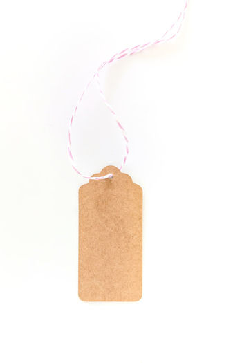 Blank tag from recycling paper isolated on white background Isolated Sale Bargain Blank Brown Brown Color Cardboard Close-up Copy Space Cut Out Discount High Key Indoors  Message No People Paper Recycled Materials Single Object Space For Text Still Life String Studio Shot Tag Template White Background