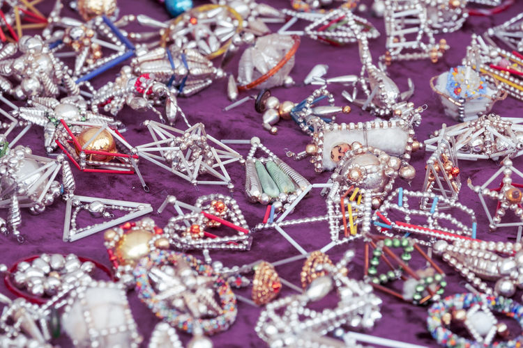 Old-fashioned Abundance Backgrounds Celebration Choice Christmas Christmas Ornament Close-up Decoration Event Flea Market For Sale Full Frame Jewelry Large Group Of Objects No People Ornate Outdoors Purple Retail Display Selective Focus Silver Colored Snow Star Shape Variation